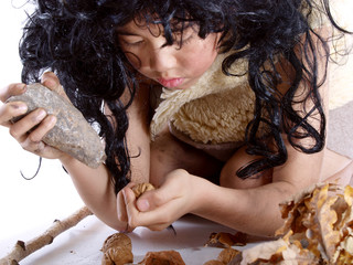 neanderthal cracking a walnut with a piece of stone