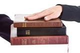 Swearing on a Stack of Bibles Hand on Top Isolated Background poster
