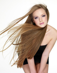 Beautiful young woman with  long straight hair