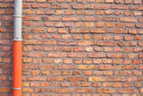 Red brick wall with gutter pipe poster