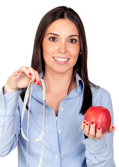 Beautiful girl with a red apple and tape-measure
