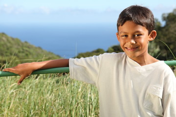 Young ethnic boy outdoor in countryside sunshine