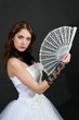 Girl with fan in white dress