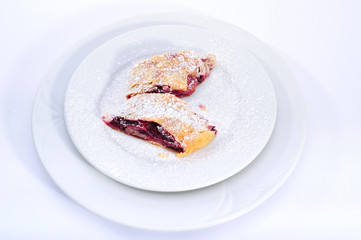sour cherry strudel in white plate