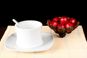 Tea cup with sweets.