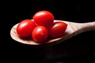 Tomatoes on a wooden spoon