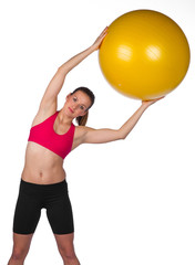 woman exercise with pilates ball