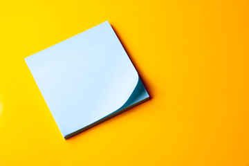 blank blue note on orange background