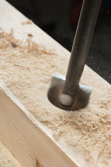 hole being drilled into wood