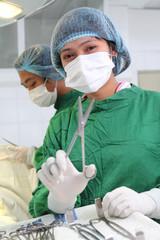 nurse with instrument