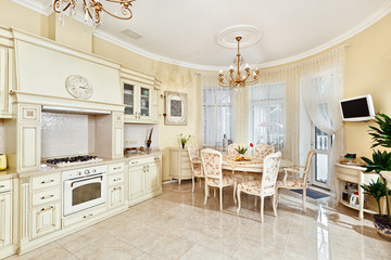 Classic style kitchen and dining room interior in beige pastoral