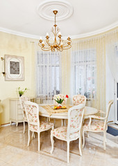 Classic style dining room interior in beige pastoral colors