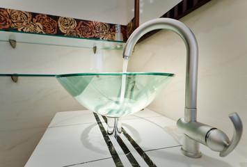 Glass sink bowl in modern minimalism bathroom interior