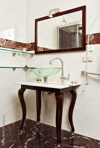 Modern bathroom interior with Glass sink bowl and mirror