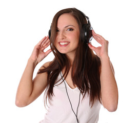 teenage girl listening music on headphones