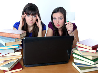 two friends are preparing for the exam for books
