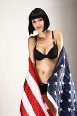 Beautiful girl with the american flag