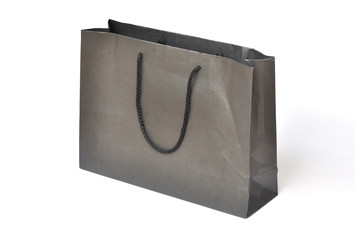 Black crumpled shopping paper bag