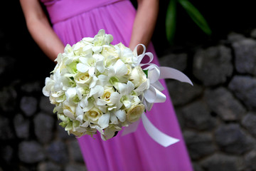 Bridesmaid holding bouquet.