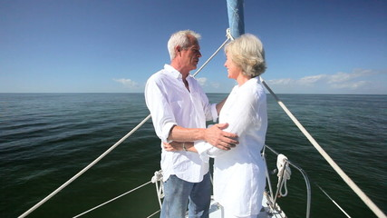 Senior Couple Enjoying Time Sailing on Luxury Yacht