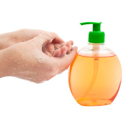 lathered hands and liquid soap