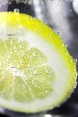 Lemon and drops of carbonated water