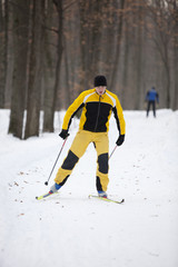 Cross-country skiing man - another in background