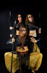 Three woman with spear