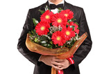 A man holding a large bouquet of flowers