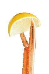 Squeezing lemon. Langoustine pincers holding lemon.