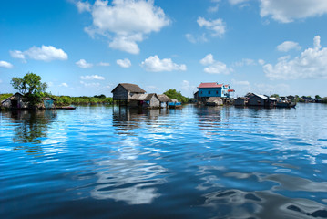 Floating House and  Houseboat on the Tonle Sap lake, Cambodia.