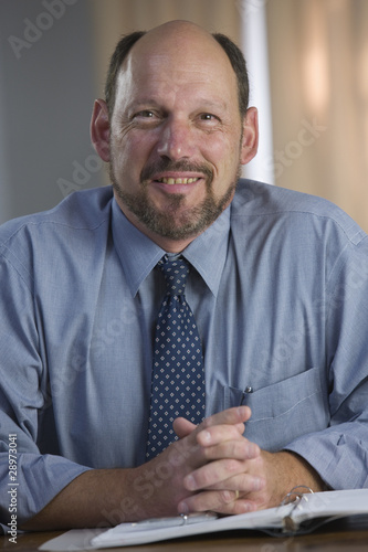 Portrait of a businessman smiling with his documents