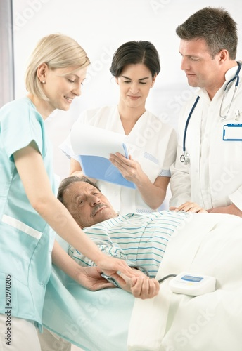 Doctors and nurse examining patient