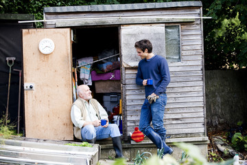 A father and his son having a break on an allotment