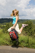 beautiful girl with backpack jump on way..
