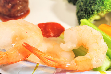 Shrimp with cocktail sauce on a party plate