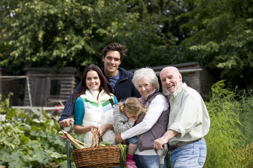 A family standing on an allotment
