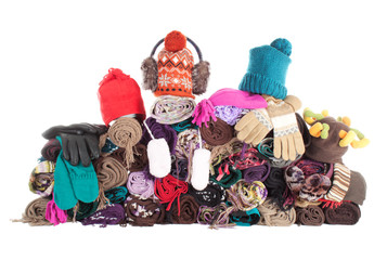 Heap of winter scarfs, hats and gloves | Isolated