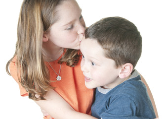 Young girl kissing boy on forehead