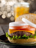juicey cheeseburger with drink