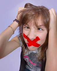 Girl with Mouth Taped