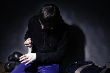 Young boxer preparing