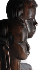 Two carved mahogany African warrior heads.