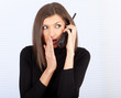 young woman with phone - gossips in secret