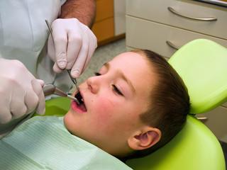 Preschool boy on dental prevention examination