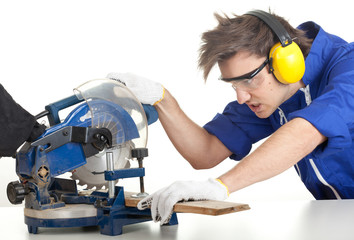 young man in overalls with saw preparing for cutting