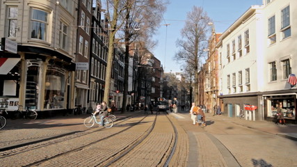 Trams driving in Amsterdam the Netherlands