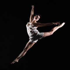 Elegant dancer jumping in air