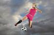 Female Soccer Player Kicking a Ball