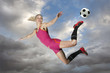 Female Soccer Player Kicking a Ball